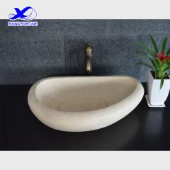 Oval beige marble counter top basin